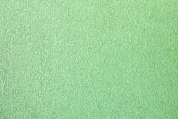 グリーン汚れたセメント壁の背景。