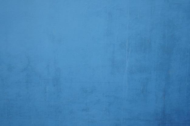青い汚れたセメント壁の背景。