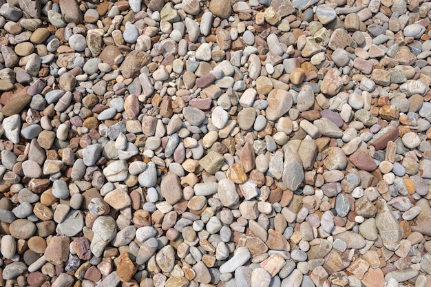 海岸のがれまたは小石のビーチの背景。