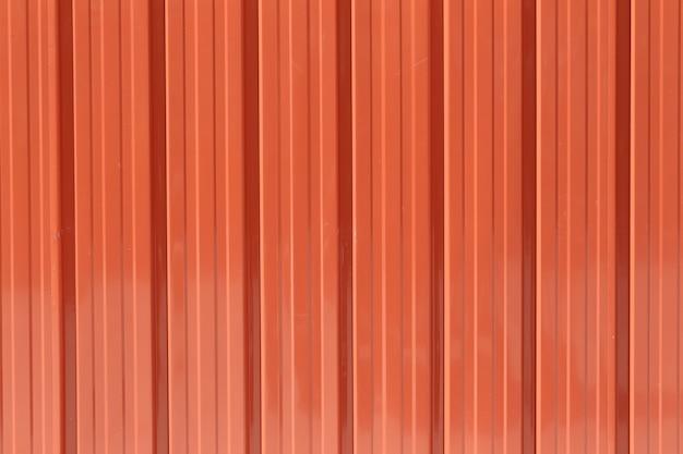 Оранжевая предпосылка текстуры стены цинка.