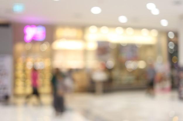 Аннотация размытие интерьера или расфокусированным торговый центр универмага.