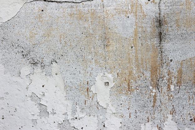 汚れや汚れ、テクスチャ背景を持つヴィンテージの古いコンクリートの壁