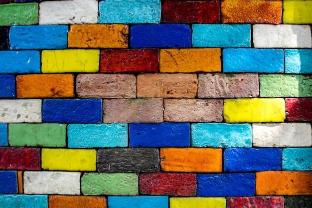 カラフルなレンガの壁の背景パターンテクスチャヴィンテージ