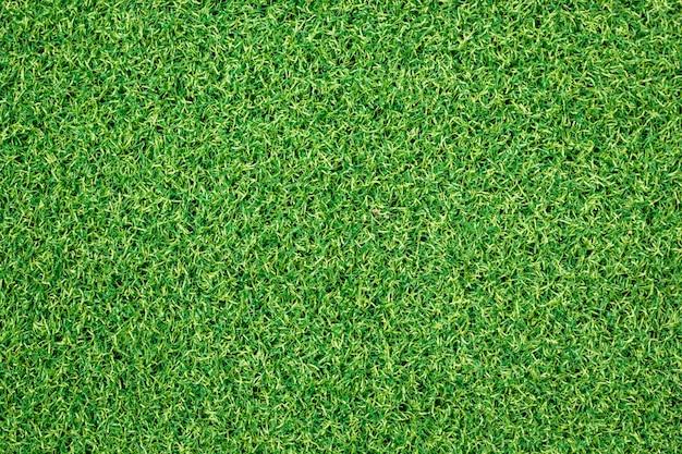 人工の緑の草の背景。