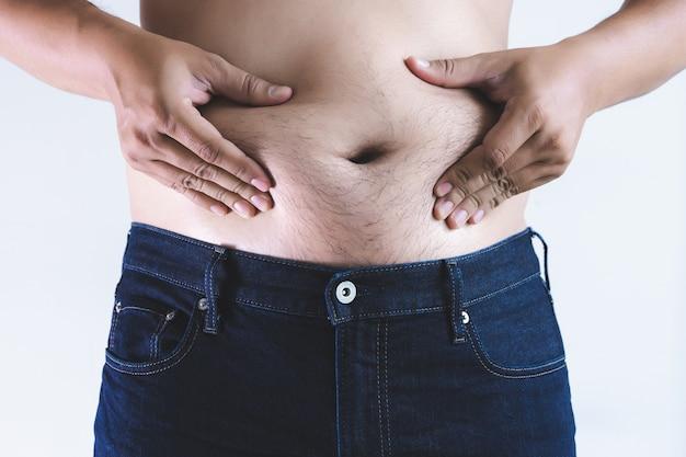 太りすぎの太い腹の太った男
