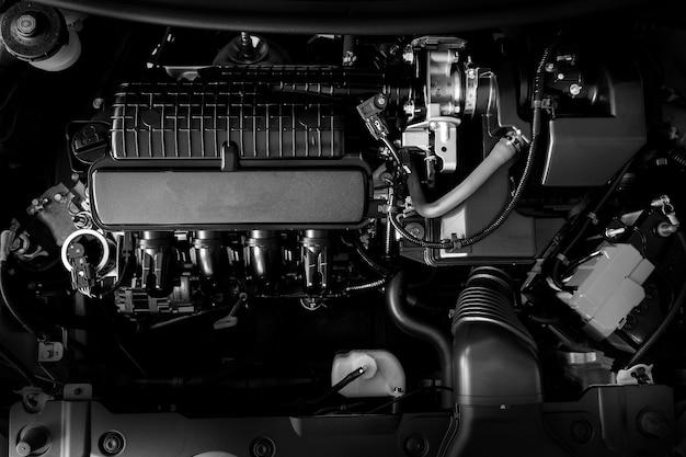 車のエンジンのモーターの概念新しい自動車エンジンの部分の詳細を閉じます白黒。