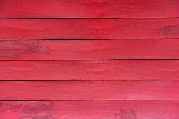 赤い板の背景色または木製の木目テクスチャ背景赤