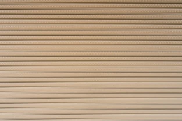 金属製のローラーシャッタードアの背景の背景のストライプ