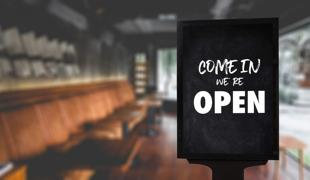 入ってください、私たちは開いています、カフェまたはレストランにサインインしてください