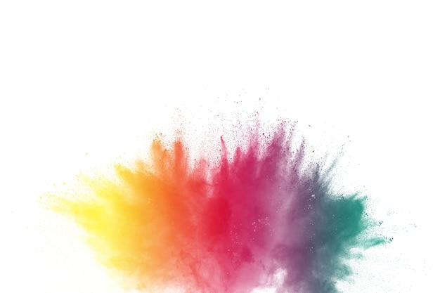 白い背景上に着色された粉の爆発のフリーズモーション