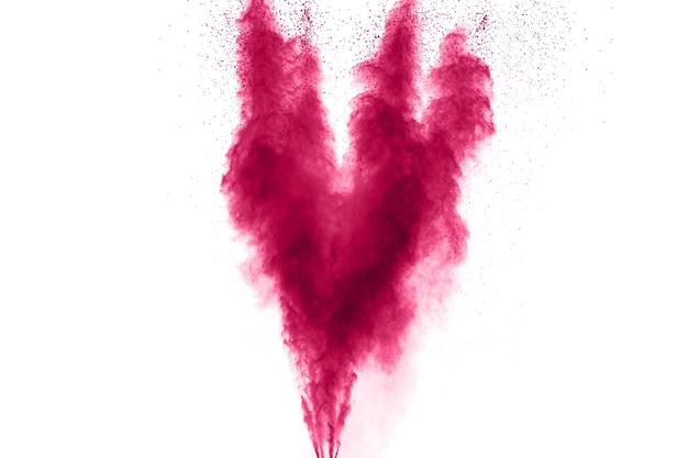 抽象的なピンクの粉塵の爆発。抽象的なピンクの粉は、白い背景にはねた。
