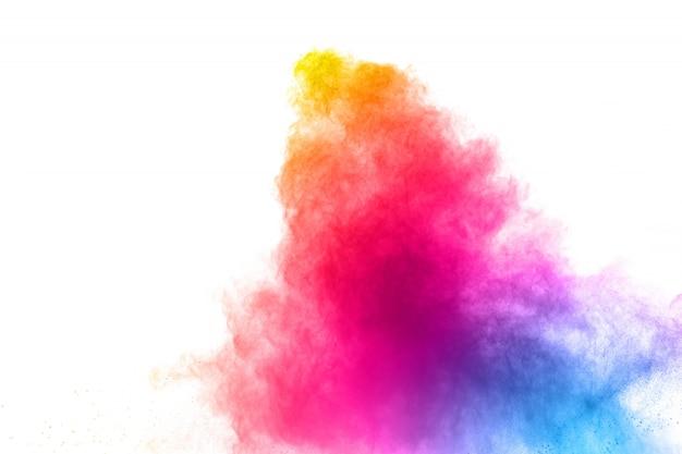 白い背景に抽象的なマルチカラーパウダー爆発