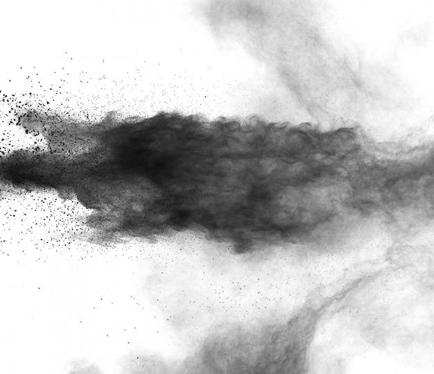 白い背景に黒い粉の爆発。黒い塵粒子のしぶき。