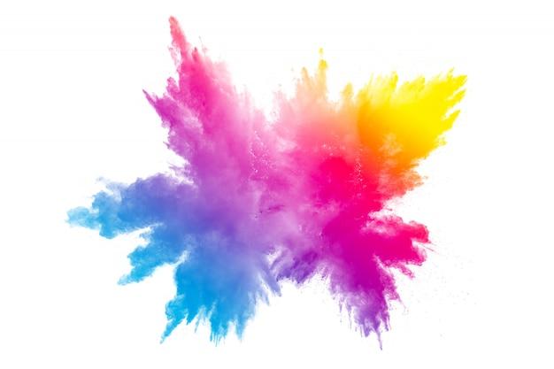 白い背景の上の多色粉体爆発。