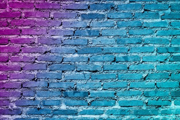 カラフルな塗られたレンガの壁のテクスチャ背景。落書きのレンガの壁、カラフルな背景。