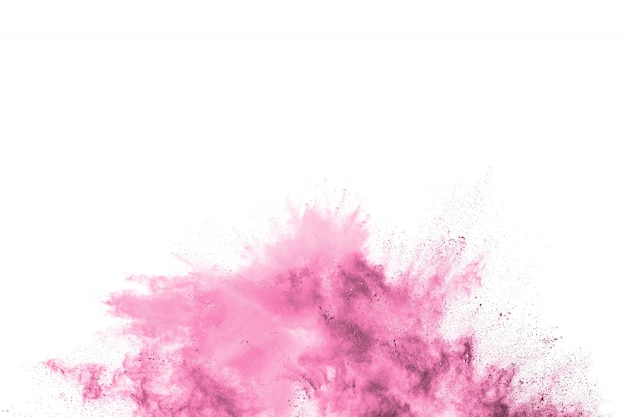 Розовый порошок взрыв. розовая пыль брызги. запущены разноцветные частицы