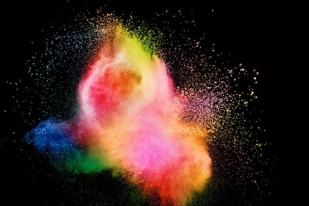 カラー粒子の抽象的な背景が破裂またははねかけます。