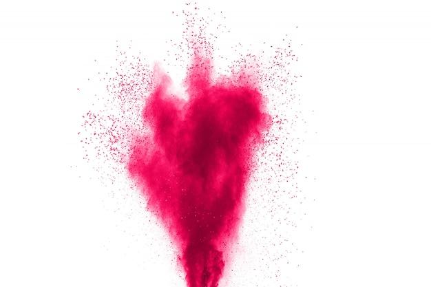 白い背景の上の抽象的なピンク粉末爆発。飛び散ったピンク色のほこりの動きを凍結します。