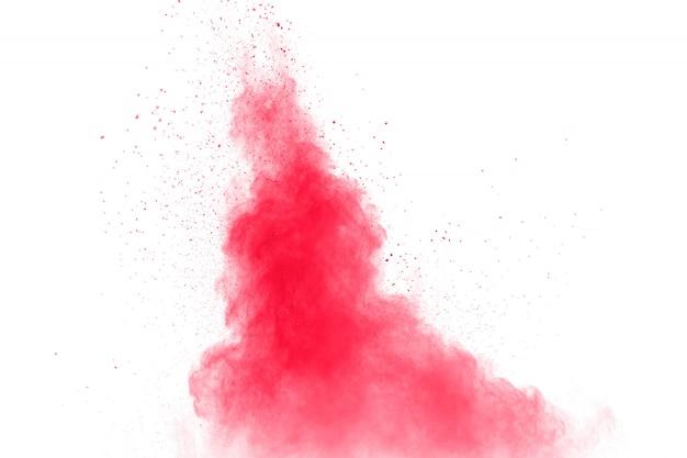 抽象的な赤いほこりが白い背景に飛び散った。