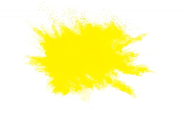 白の抽象的な黄色い粉末爆発