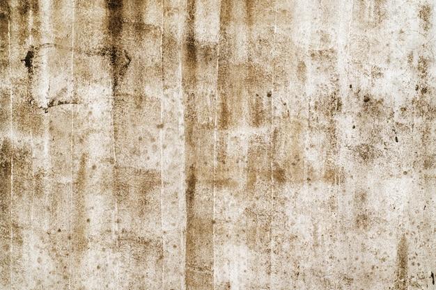 古い灰色のセメントまたはコンクリートの壁。グランジ漆喰漆喰のテクスチャ背景。