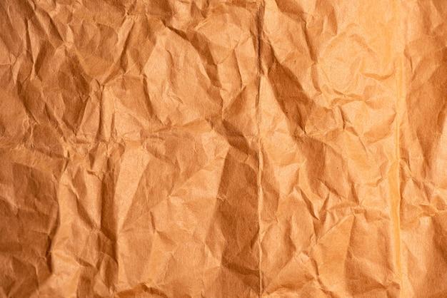 茶色のしわリサイクル紙ビンテージスタイルの背景。