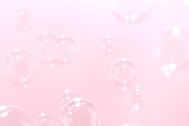 ピンクのシャボン玉の背景。