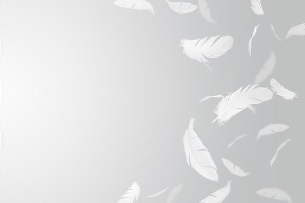羽の抽象的な背景。白い羽が空中に浮かんでいます。