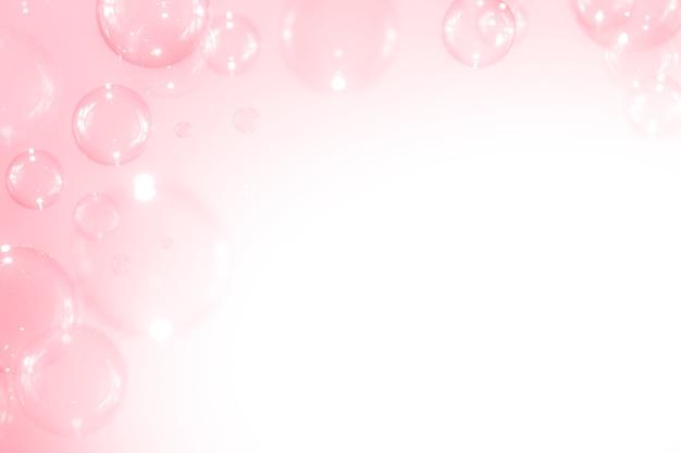 美しいピンクのシャボン玉の背景。