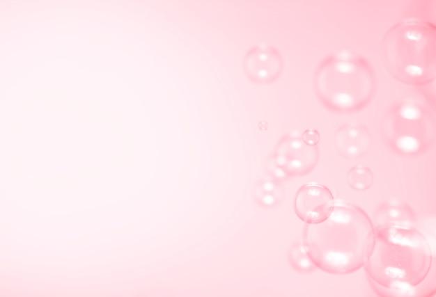 ピンクの背景のシャボン玉