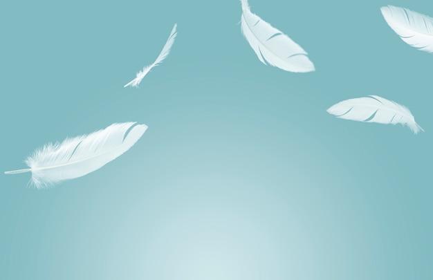 Белые перья, плавающие в воздухе