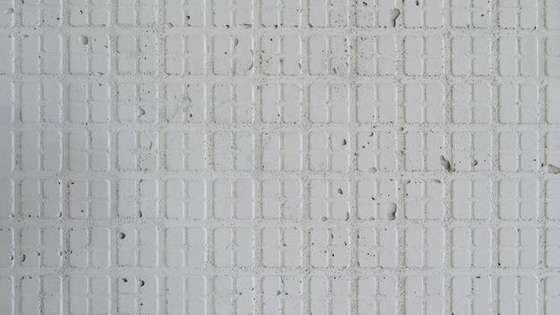 背景の古典的な模様のセメントの壁のテクスチャ。