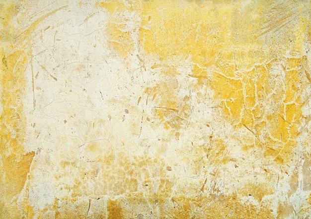 黄色の色の古いコンクリートの壁のテクスチャ背景