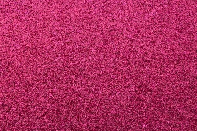 ピンクの光沢紙テクスチャ背景