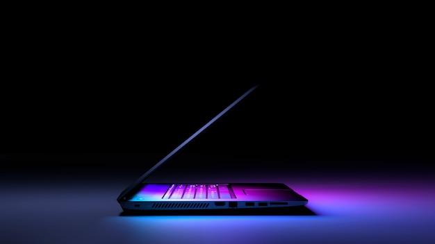 Взгляд со стороны портативного пк с светом цвета на темноте. технология игровой концепции.