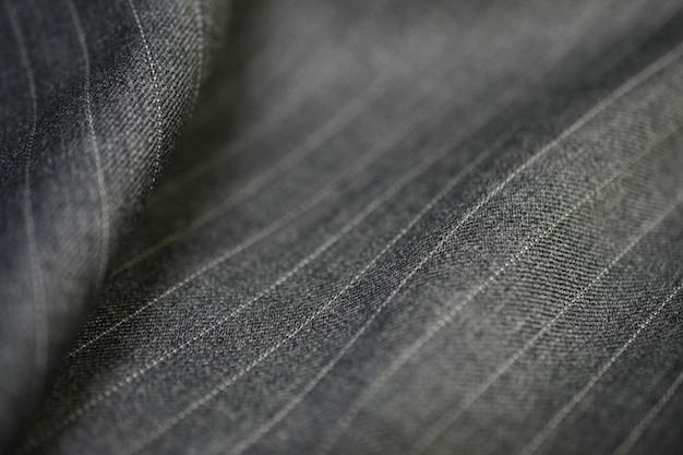 Крупным планом серебряная текстура ткани костюма, фотосессия по глубине резкости для объекта