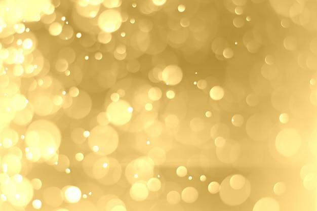 クリスマスの背景と新年あけましておめでとうございます。背景の円形の黄金ボケ。抽象的な背景。