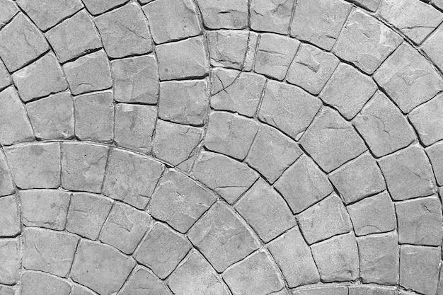 抽象的な背景のための石の地面にたくさんの行