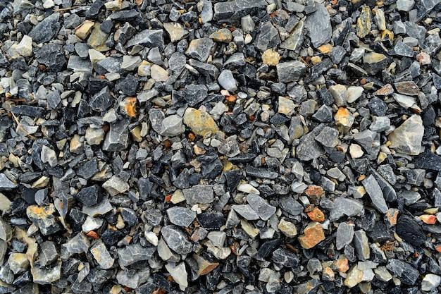 背景の汚れた石の地面がたくさん