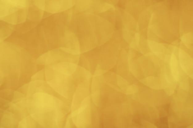 抽象的なゴールドの光ボケクリスマスライトぼやけて背景