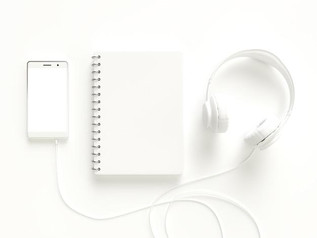 Ноутбук со смартфоном и наушниками белого цвета