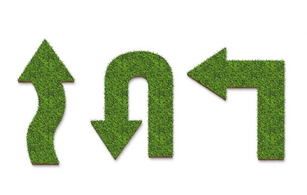 白で隔離され、緑の芝生の矢印の表面