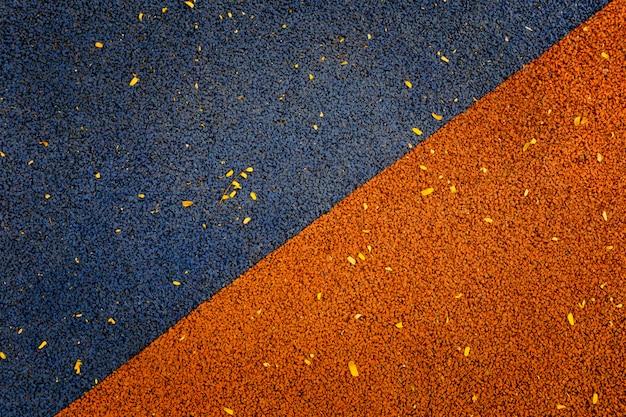 ゴム製フローリングの青とオレンジ色