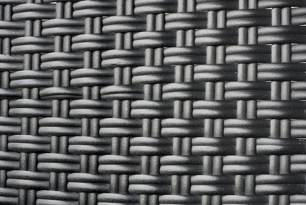 Черный ротанга ткать текстуру фона