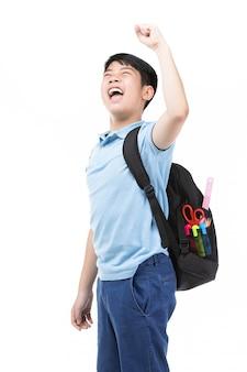 Милый азиатский ребенок с школьным рюкзаком