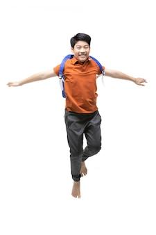 白で隔離されるジャンプ幸せな小さなアジアの子供の肖像画