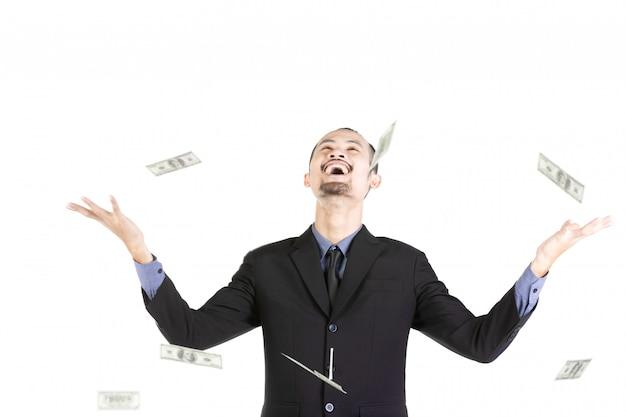 白で隔離のお金を持つビジネス男