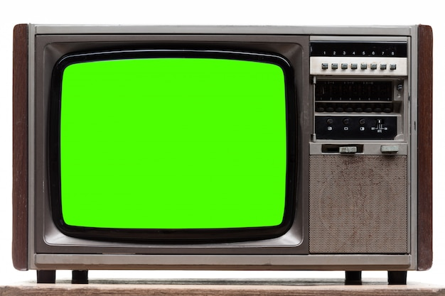 白で隔離される緑色の画面で古いレトロなテレビ