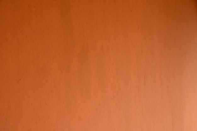 オレンジ色のセメント壁ヴィンテージ