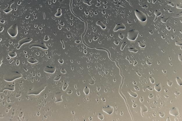 車の表面の床のテクスチャ背景に水滴